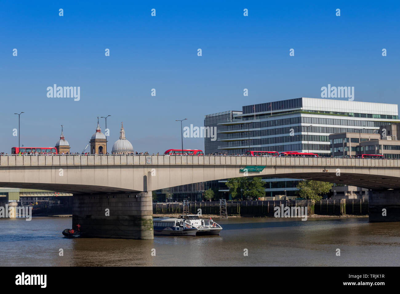 Morning commute on London Bridge - Stock Image