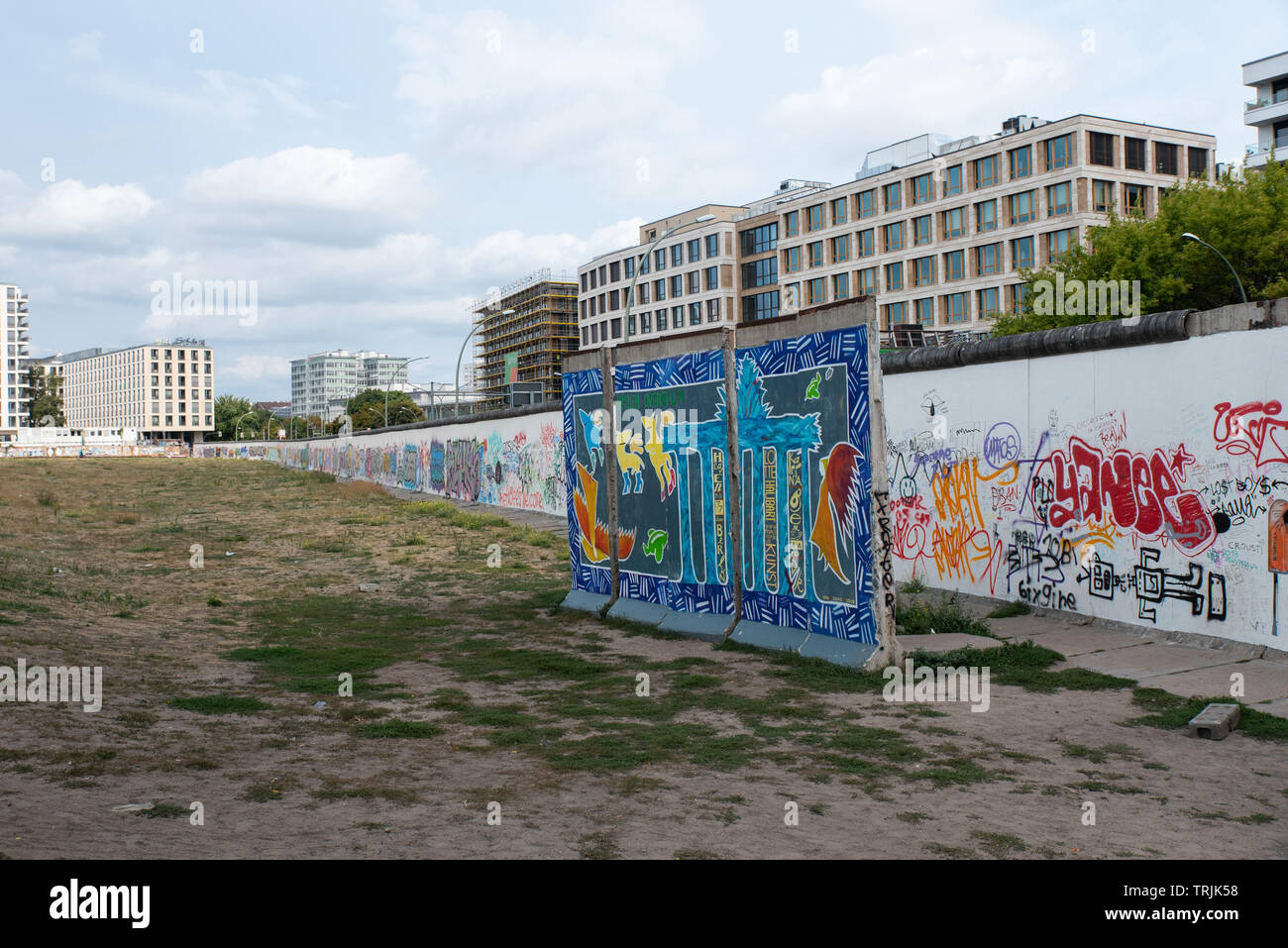 The Berlin Wall is covered with mural paintings and graffitti. Stock Photo