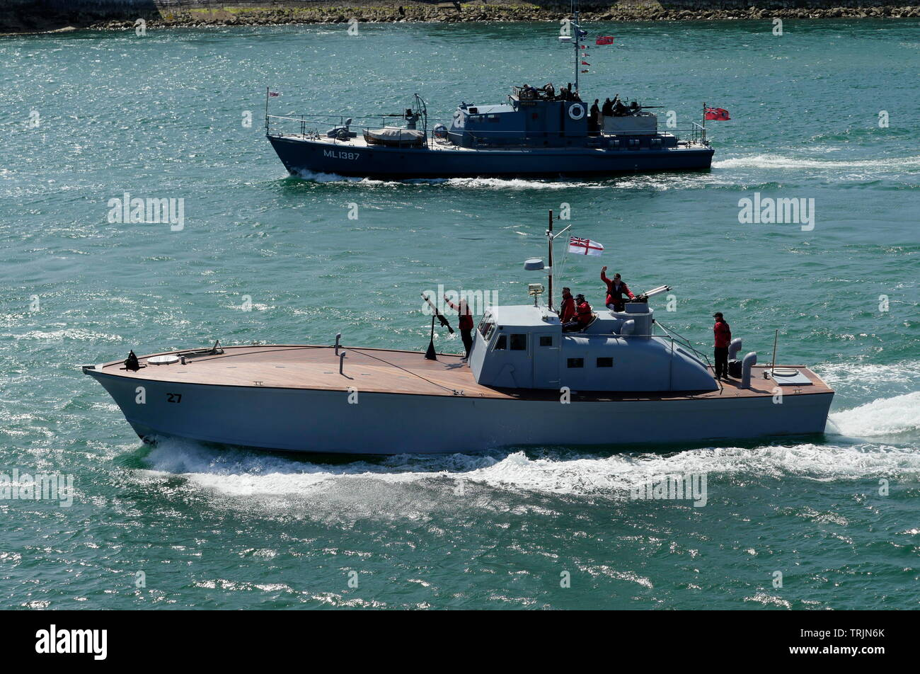 AJAXNETPHOTO. 3RD JUNE, 2019. PORTSMOUTH, ENGLAND. - RESTORED WARHORSE HEADS OUT - THE 63FT EX MA/SB 27 (MOTOR ANTI SUBMARINE BOAT) ORIGINALLY COMMISSIONED INTO THE ROYAL NAVY IN 1941, IS THE LATEST ADDITION TO THE PNBPT (PORTSMOUTH NAVAL BASE POWERBOAT TRUST) FOLLOWING A THREE YEAR RESTORATION TO WARTIME CONFIGURATION BY D-DAY REVISITED CHARITY. SEEN HERE OUTWARD BOUND TO NORMANDY AS PART OF THE 75TH D-DAY ANNIVERSARY FLOTILLA IN COMPANY WITH THE RESTORED HDML 1387 (HARBOUR DEFENCE MOTOR LAUNCH) MEDUSA (TOP). PHOTO;JONATHAN EASTLAND/AJAX REF; GX8_190306_352 - Stock Image