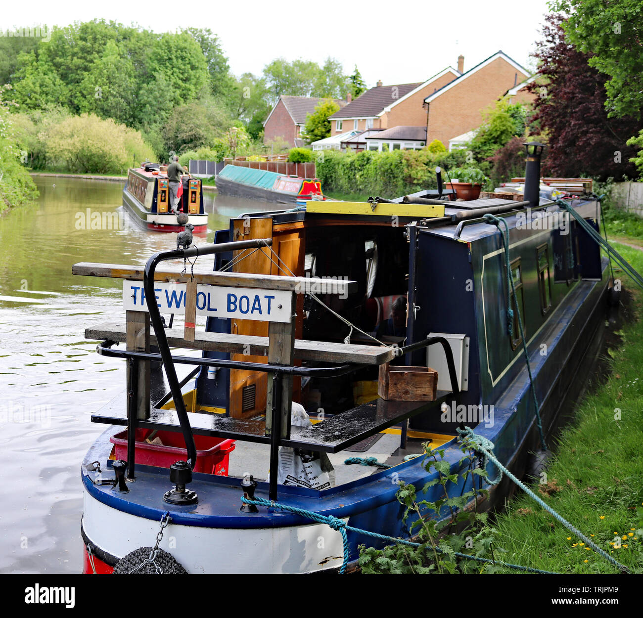 The Wool Boat, Coffee Boat and Towy in Middlewich.  Three canal working boats together on the Trent and Mersey canal, one an old one and two modern. - Stock Image