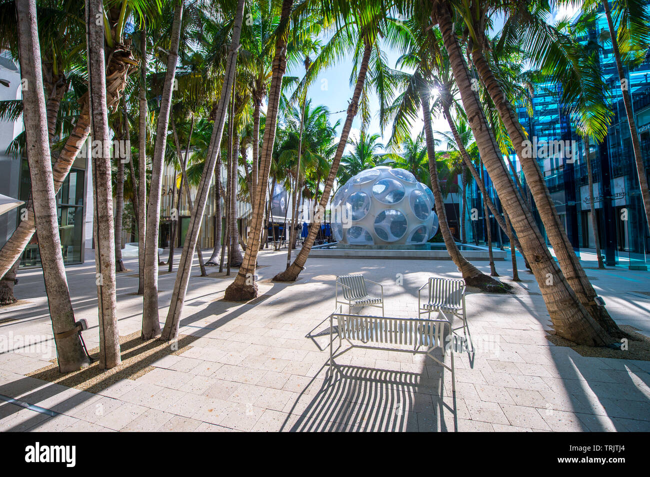 MIAMI - SEPTEMBER, 2018: Palm trees surround a modern re-creation of Buckminster Fuller's Fly's Eye Dome, a parking entrance in the Design District. Stock Photo