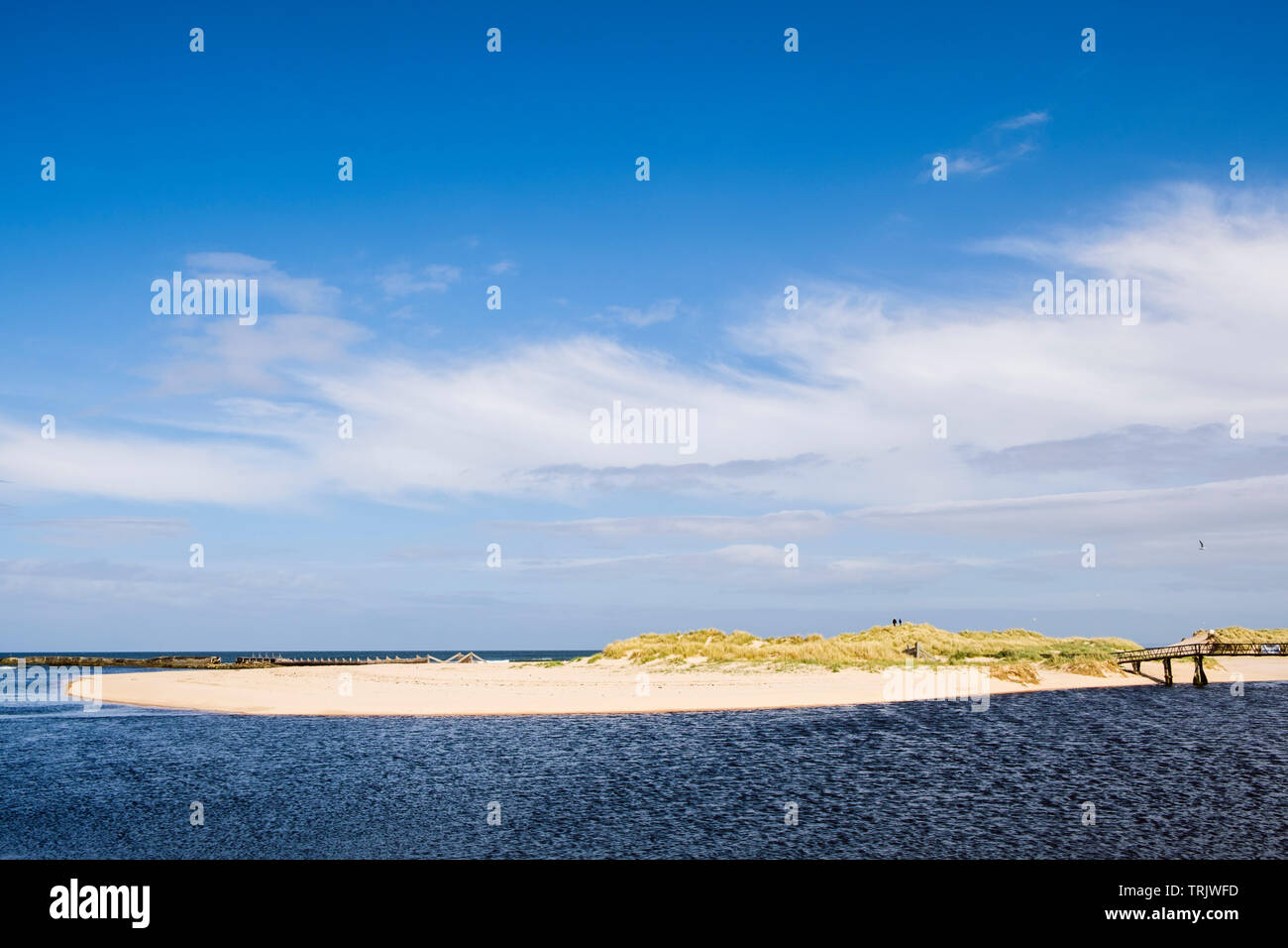 View to sandy East beach and sand dunes across Lossie River mouth from seafront on Moray Firth coast. Lossiemouth, Moray, Scotland, UK, Britain - Stock Image