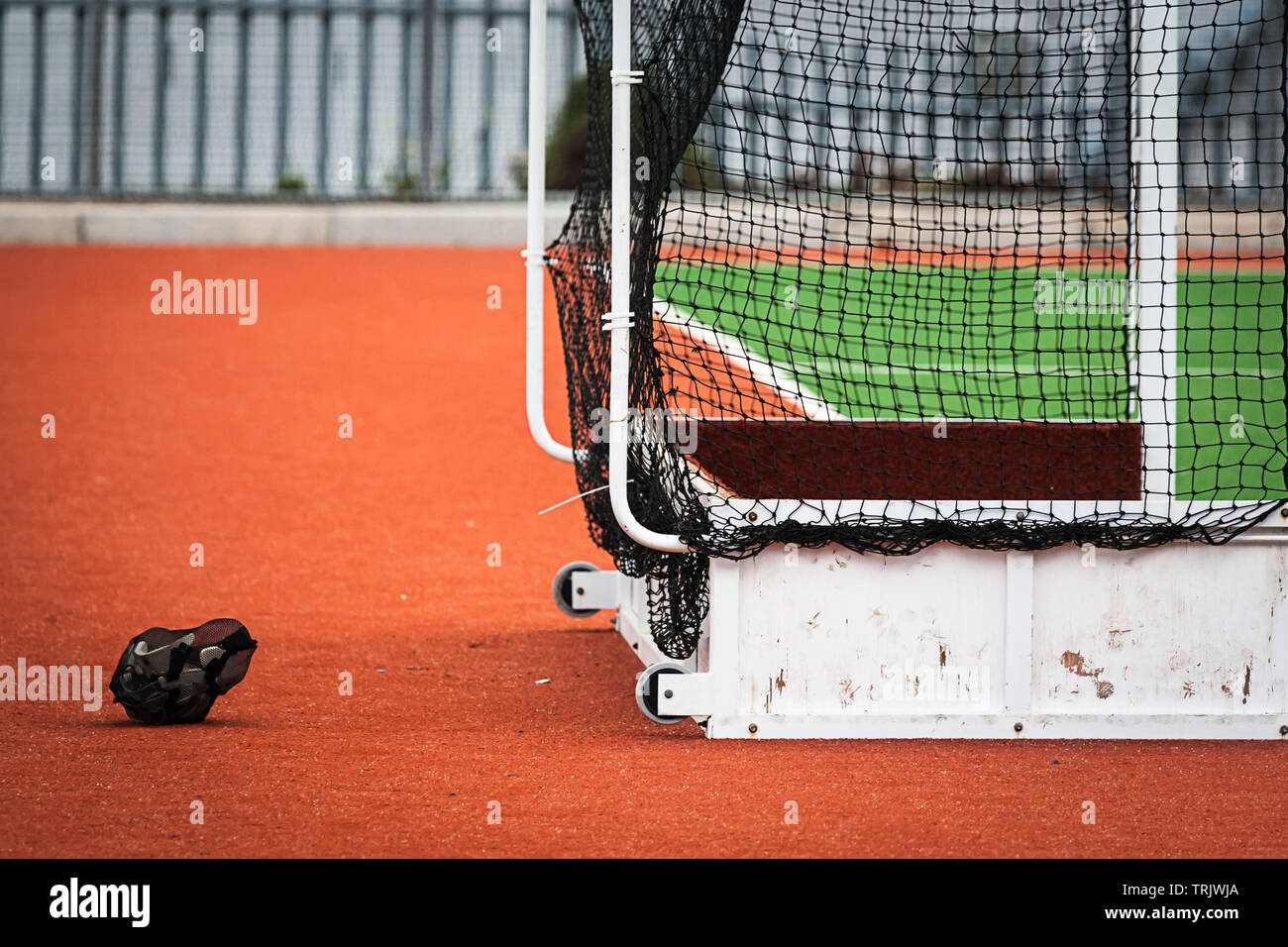 Goal box on astro hockey field with helmet in view. Stock Photo