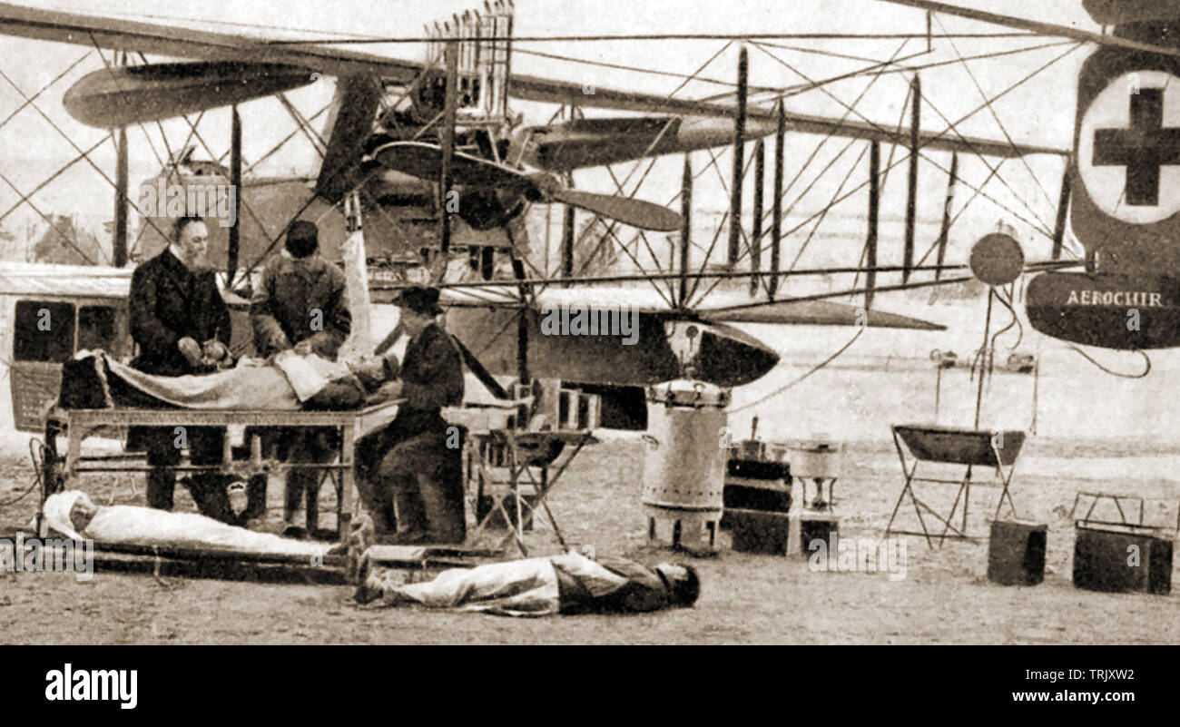 WWI - French AEROCHIR mobile air ambulance aircraft with medical staff  xraying a patien using equipment it carried (Voisin X biplane) - Stock Image