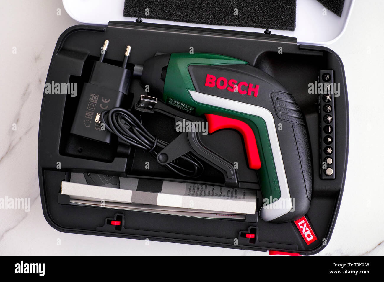 Tambov, Russian Federation - February 09, 2019 Bosch Cordless Screwdriver in open case with bit set, instruction and charger. - Stock Image