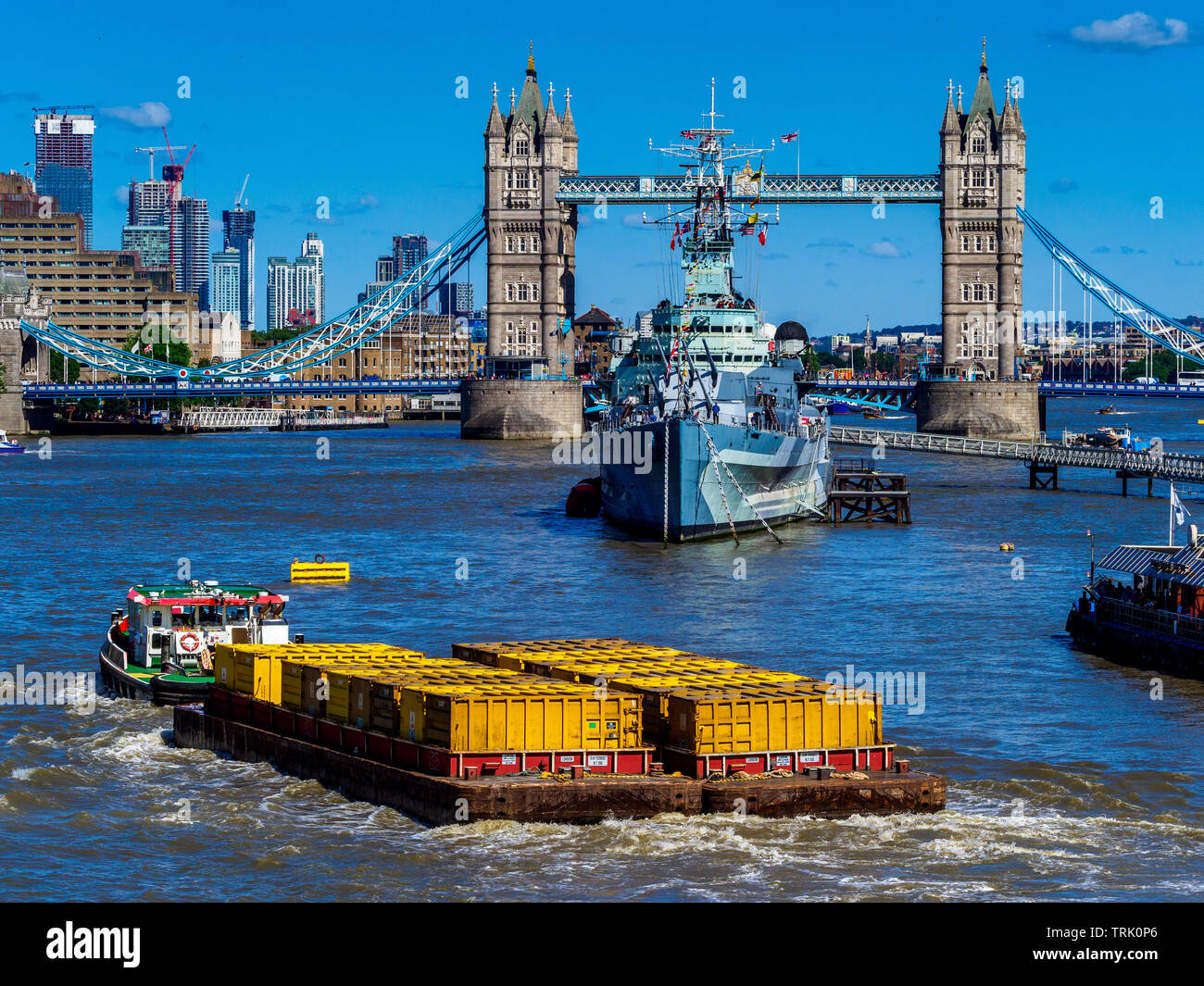 London Waste - Barges full of London waste are towed down the River Thames to the Riverside Resource Recovery Energy from Waste facility at Belvedere - Stock Image