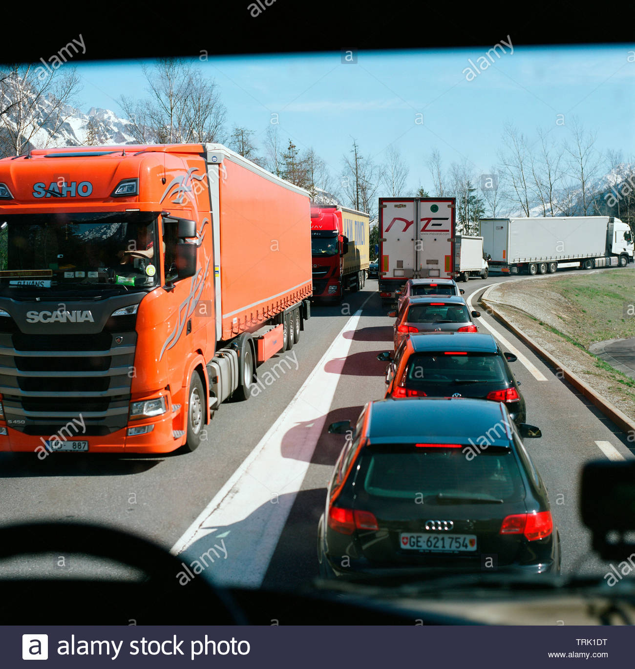 View through truck windscreen - traffic congestion heading up to the Mont Blanc Tunnel, along route N205 / E 25, in France. - Stock Image