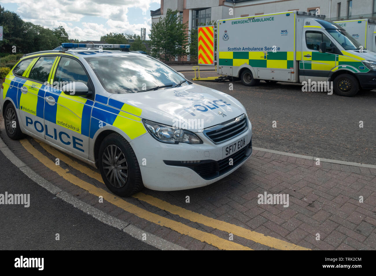 A Police Car and an Emergency Ambulance parked outside the Accident and Emergency Unit of University Hospital, Wishaw, North Lanarkshire, Scotland, UK - Stock Image