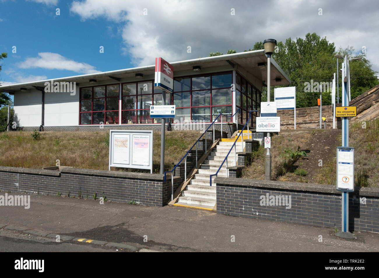 Bus stop outside Wishaw Train station in South Lanarkshire, Scotland. - Stock Image