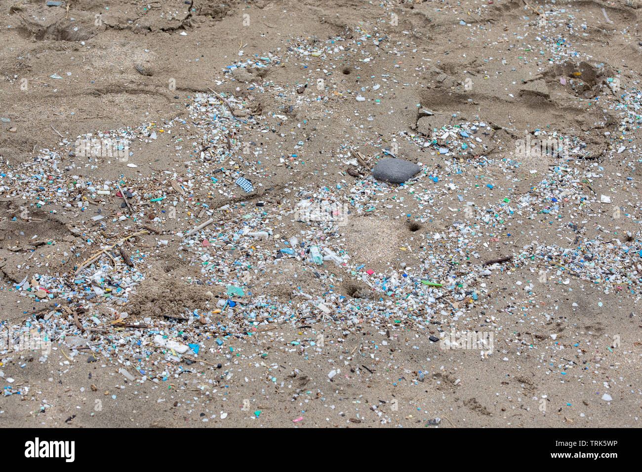 Thousands and thousand of bits of plastic mark the high water mark on this Northshore beach. Much of the north side of the island of Maui in inaccessi - Stock Image