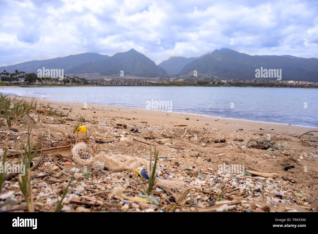 Thousands and thousand of bits of plastic and fishing line mark the high water mark on this Northshore beach. Much of the north side of the island of - Stock Image