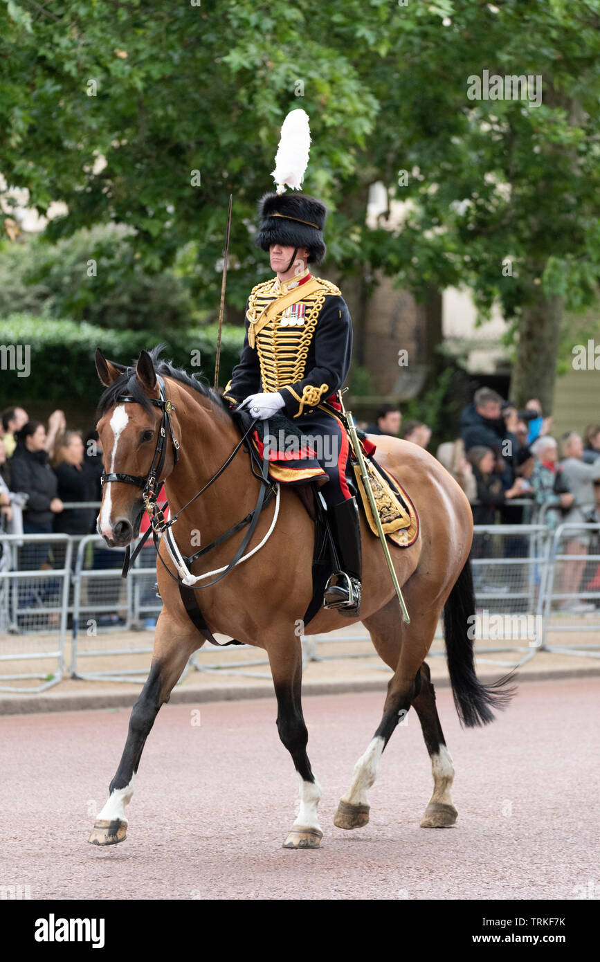 Lead charger horse Lucy Glitters ridden by Major Harry Wallace down The Mall, London, UK from Horse Guards Parade for the Trooping of the Colour 2019. Kings Troop Royal Horse Artillery - Stock Image