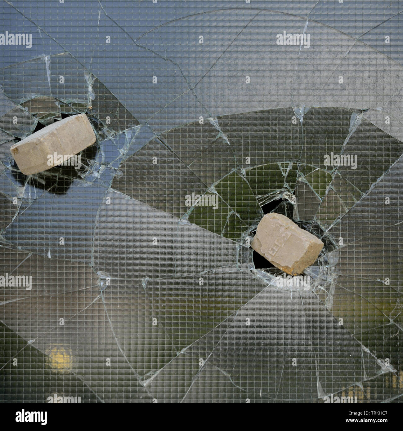 Briks trapped Broken Window - Stock Image