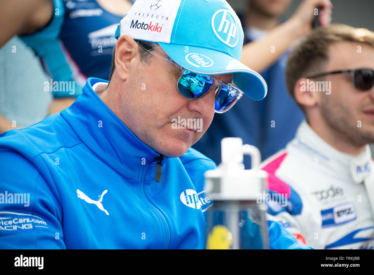 Mark Blundell BTCC Racing Driver at Thruxton During the Kwikfit British Touring Car Championship Weekend of May 18th and 19th 2019 - Stock Image