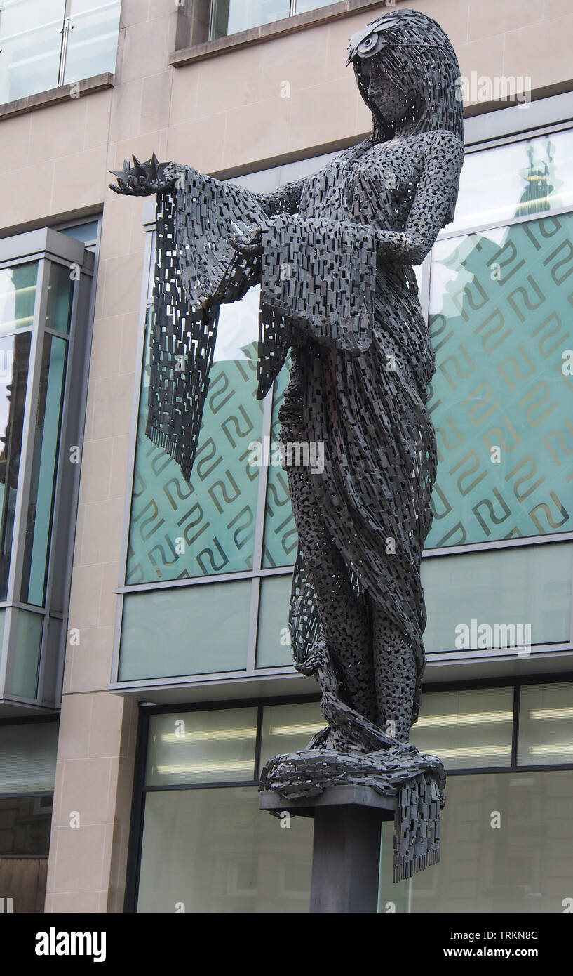 Statue of Minerva, a Roman goddess, created by Andy Scott on Briggate, the main street in Leeds city centre, Yorkshire, England, UK. - Stock Image