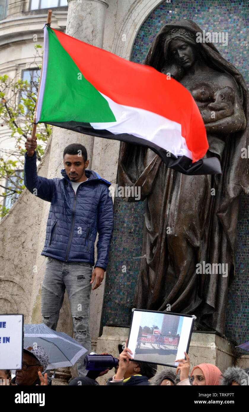 June 8, 2019.  Supporters of the Sudanese Uprising campaign in Piccadilly Gardens, city centre Manchester, uk. Since December, 2018, people in Sudan and elsewhere have called for political reform and a civilian led government in Sudan. In April the military removed President Omar al-Bashir from power. - Stock Image