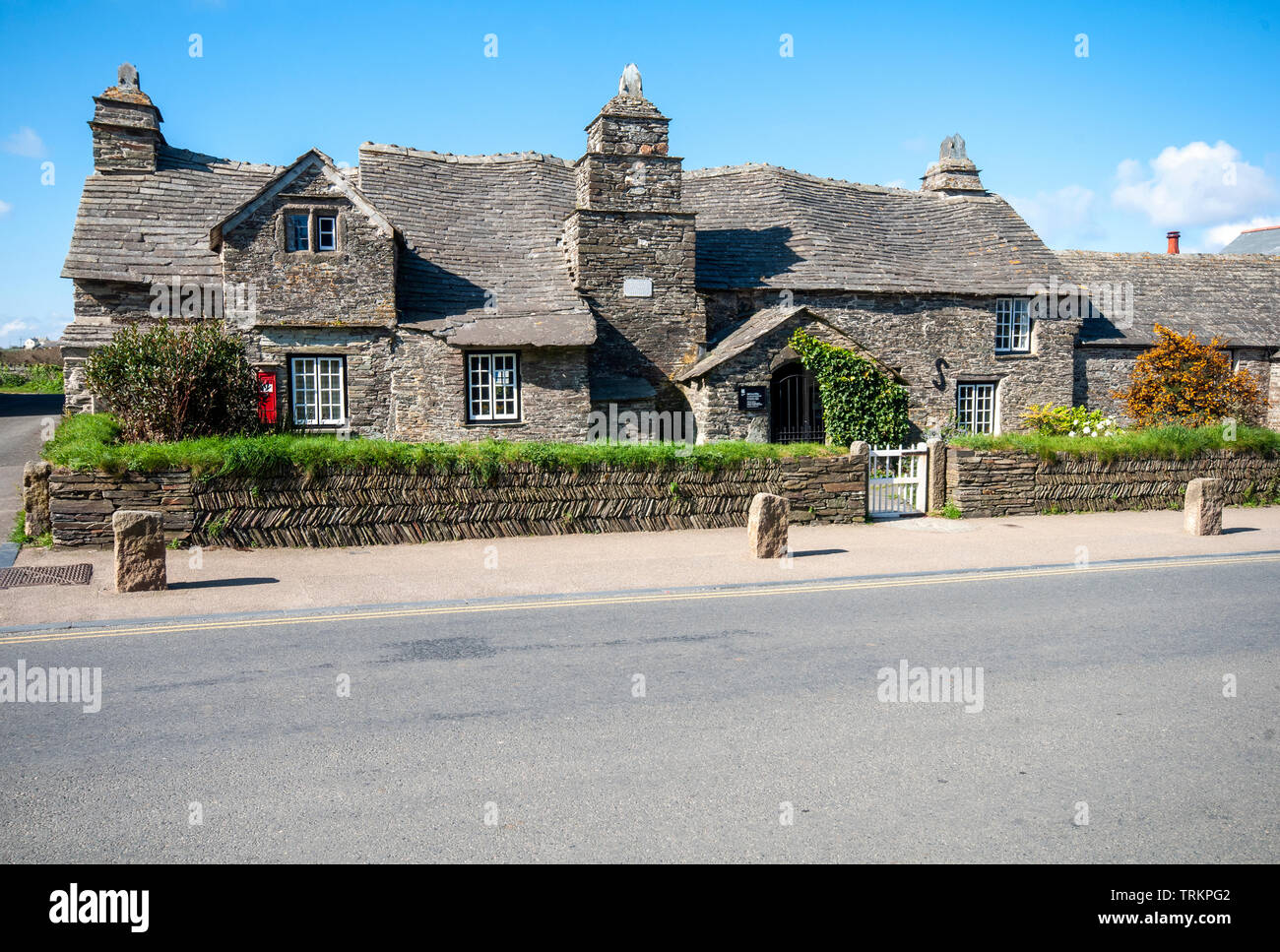The old post office at Tintagel in Cornwall, England, UK. The 14th century stone house was built to the plan of a medieval manor house. Stock Photo