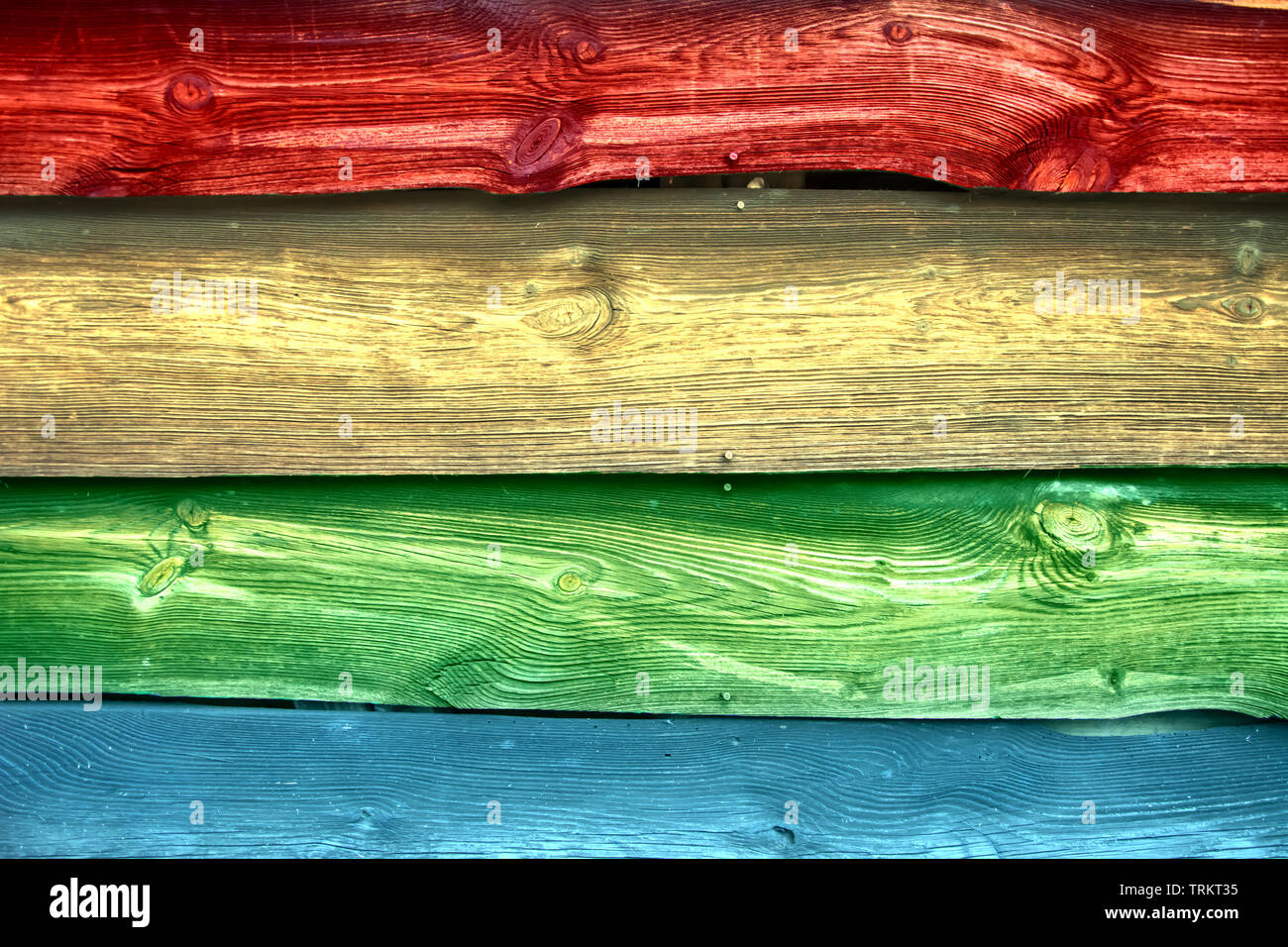 Symbol of tolerance and diversity. Rainbow colored old weathered wooden boards - Stock Image
