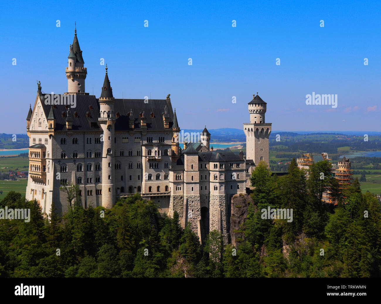 A view of the Neuschwanstein Castle in Germany. Neuschwanstein Castle is a 19th-century Romanesque Revival palace near Fussen, commission - Stock Image