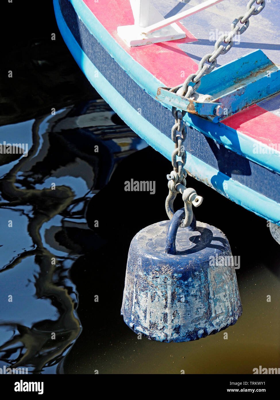 A mud weight is used as an anchor for boats mooring in the middle of a Broad. The weight sinks into the soft mud on the bottom . Stock Photo