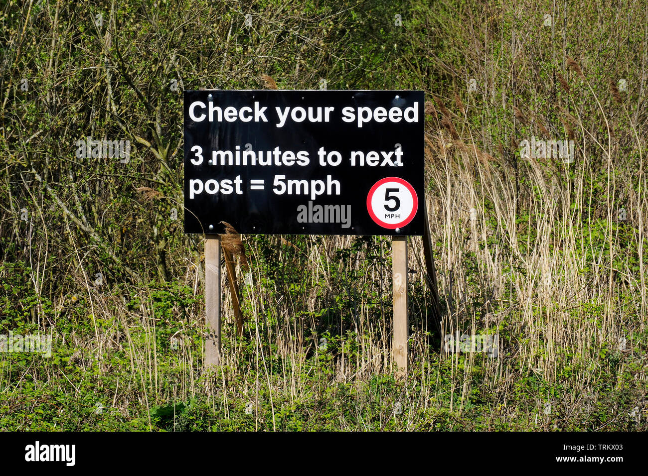 There is a 5 mph speed limit on the Norfolk Broads. This sign near Horning reminds boat skippers of the need to check their speed. Stock Photo
