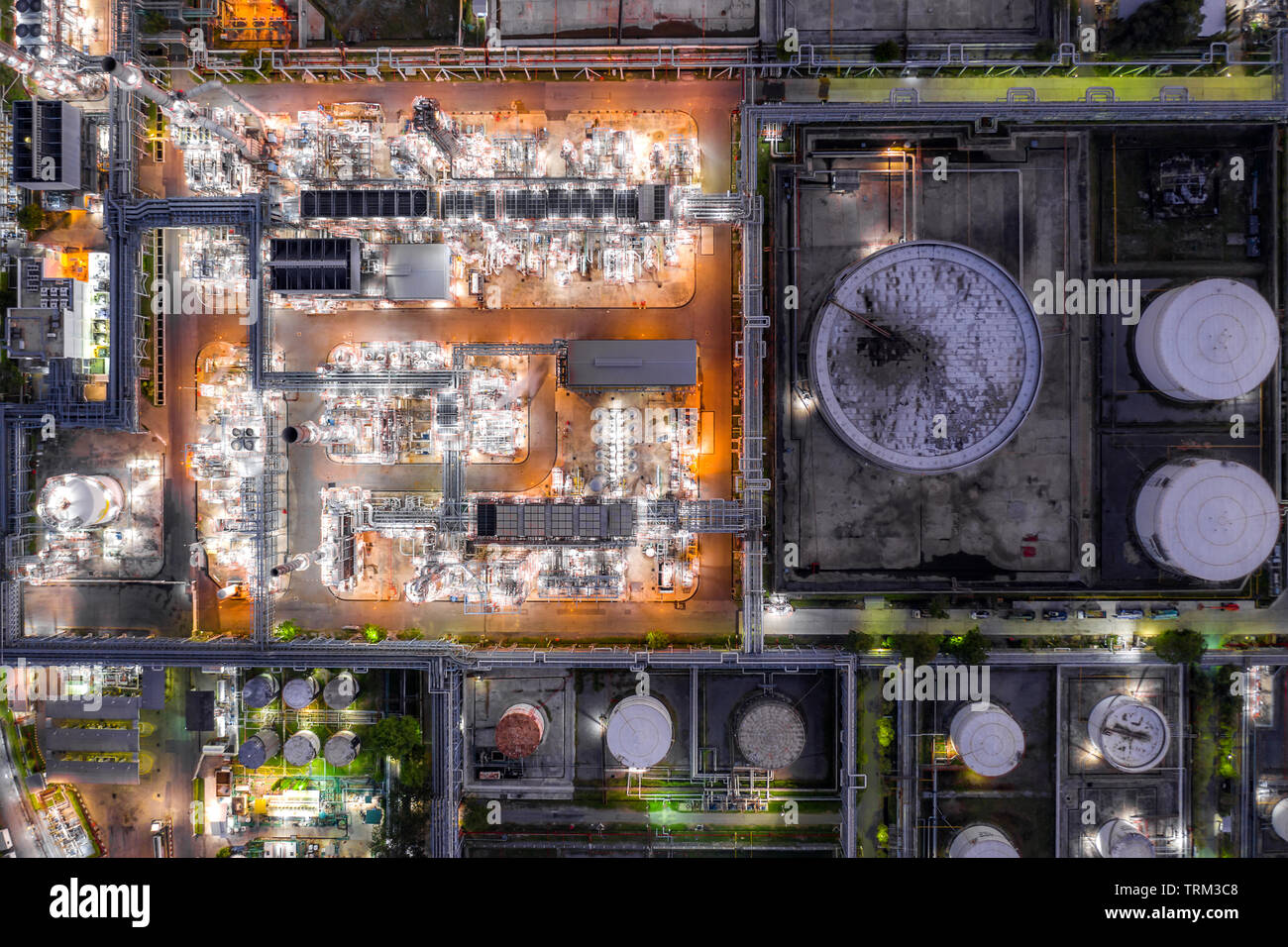 Aerial view oil refinery and gas refinery plant form industry zone at night. Stock Photo