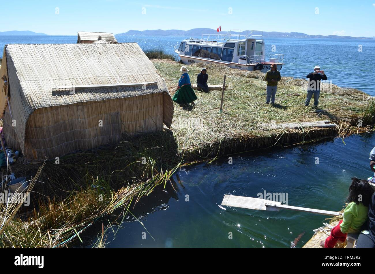 Titicaca,Puno,Peru .Floating houses on Lake Titicaca. - Stock Image