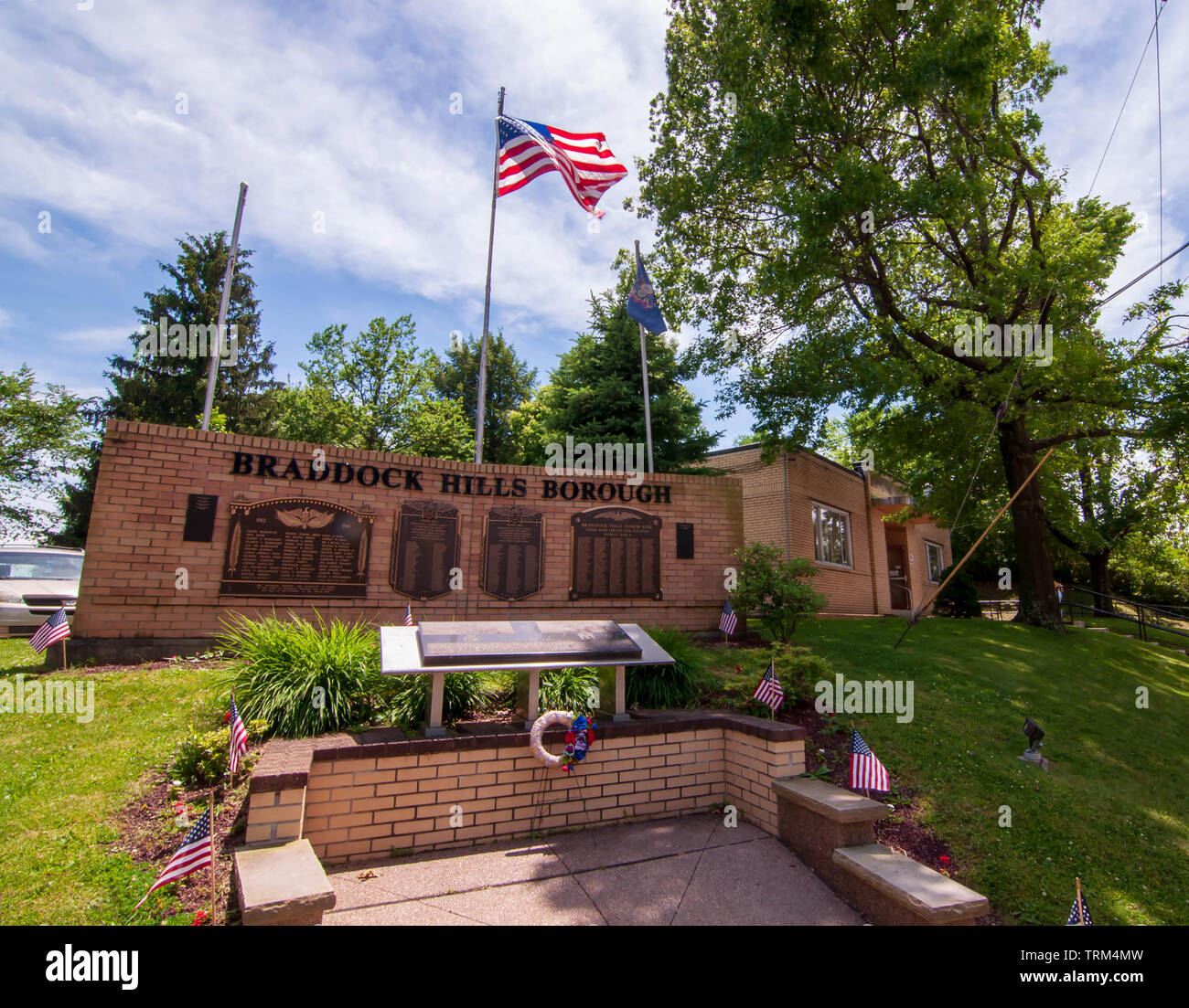 The Braddock Hills Borough War Memorial in front of the old borough building on a spring day in Braddock Hills, Pennsylvania, USA - Stock Image