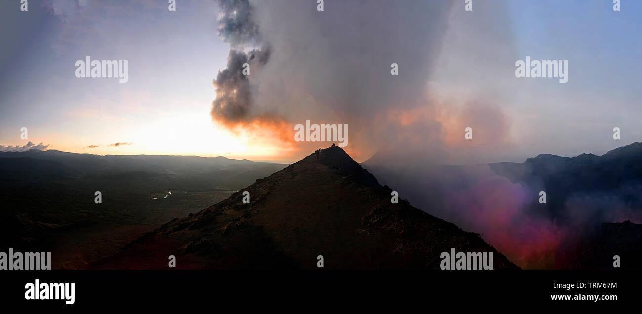Glowing Lava, fumaroles, hot gases  and sparks at erupting Mt Yasur Volcano at sunset, Tanna Island, Vanuatu - Stock Image