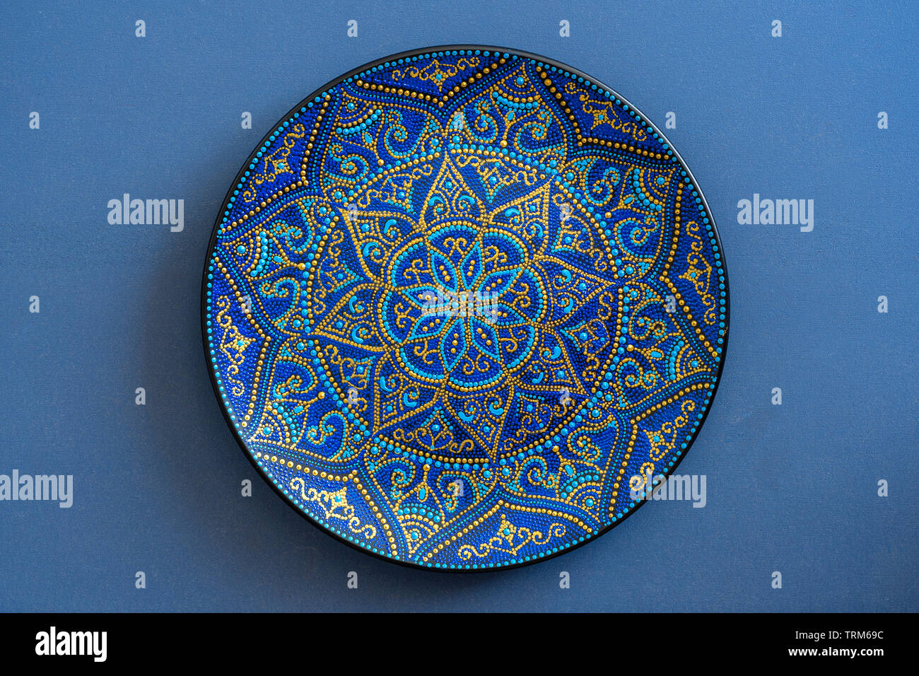 Decorative Ceramic Plate With Blue And Golden Colors
