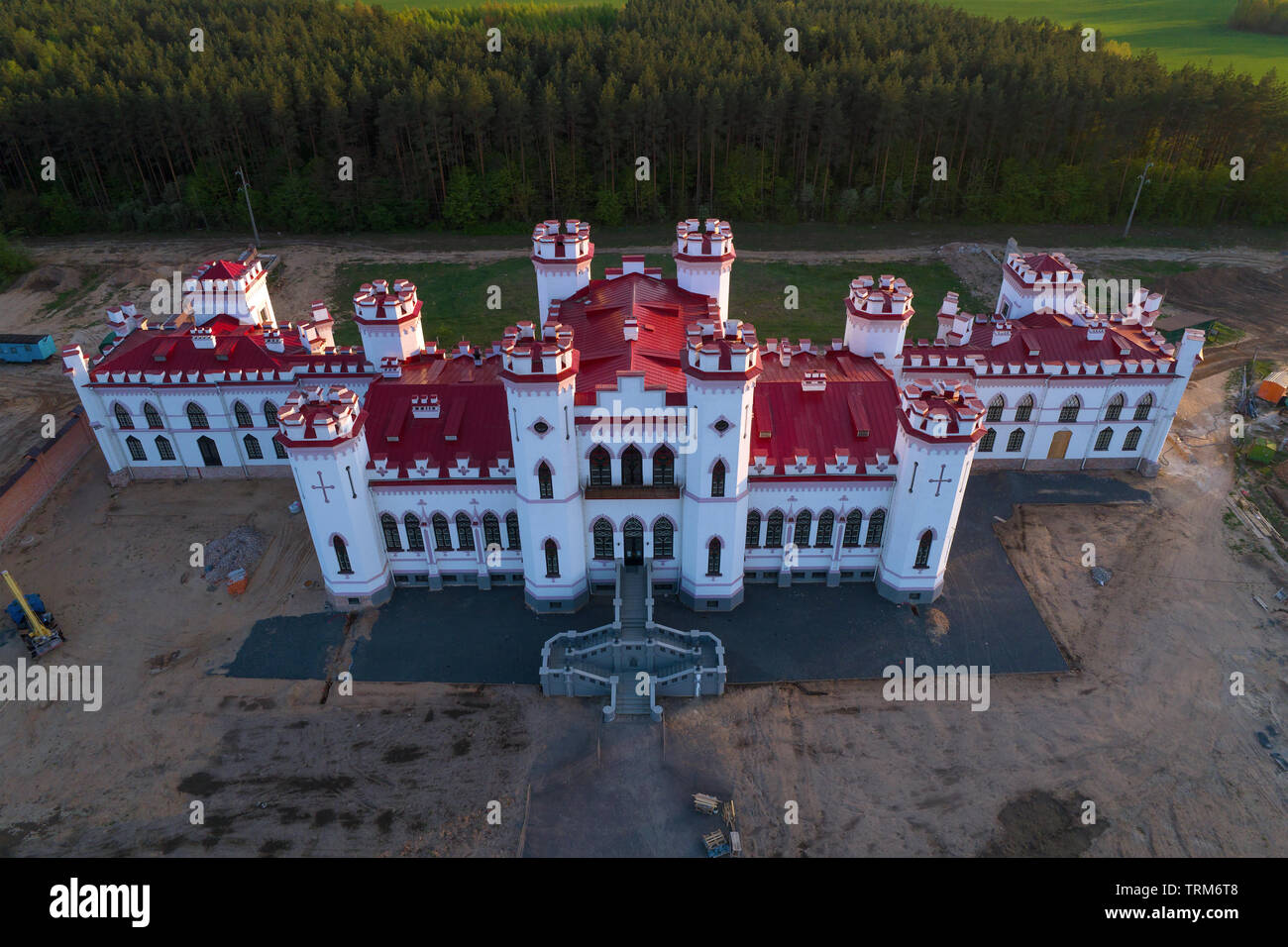 Renovated ancient castle-palace of Puslovsky close up on April evening (aerial photography). Kossovo, Belarus - Stock Image
