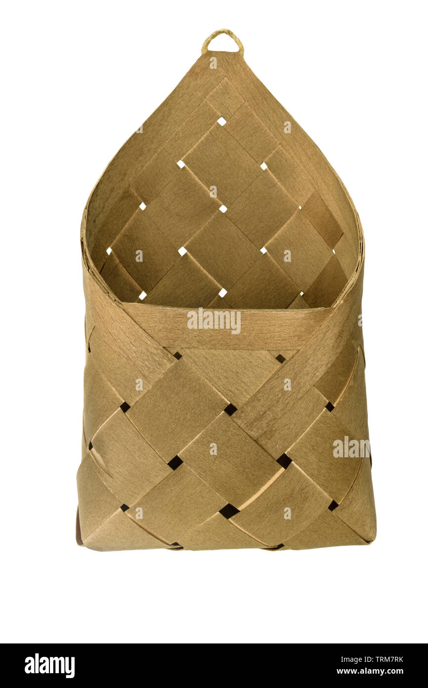 Wicker basket made from wood and isolated on white background - Stock Image