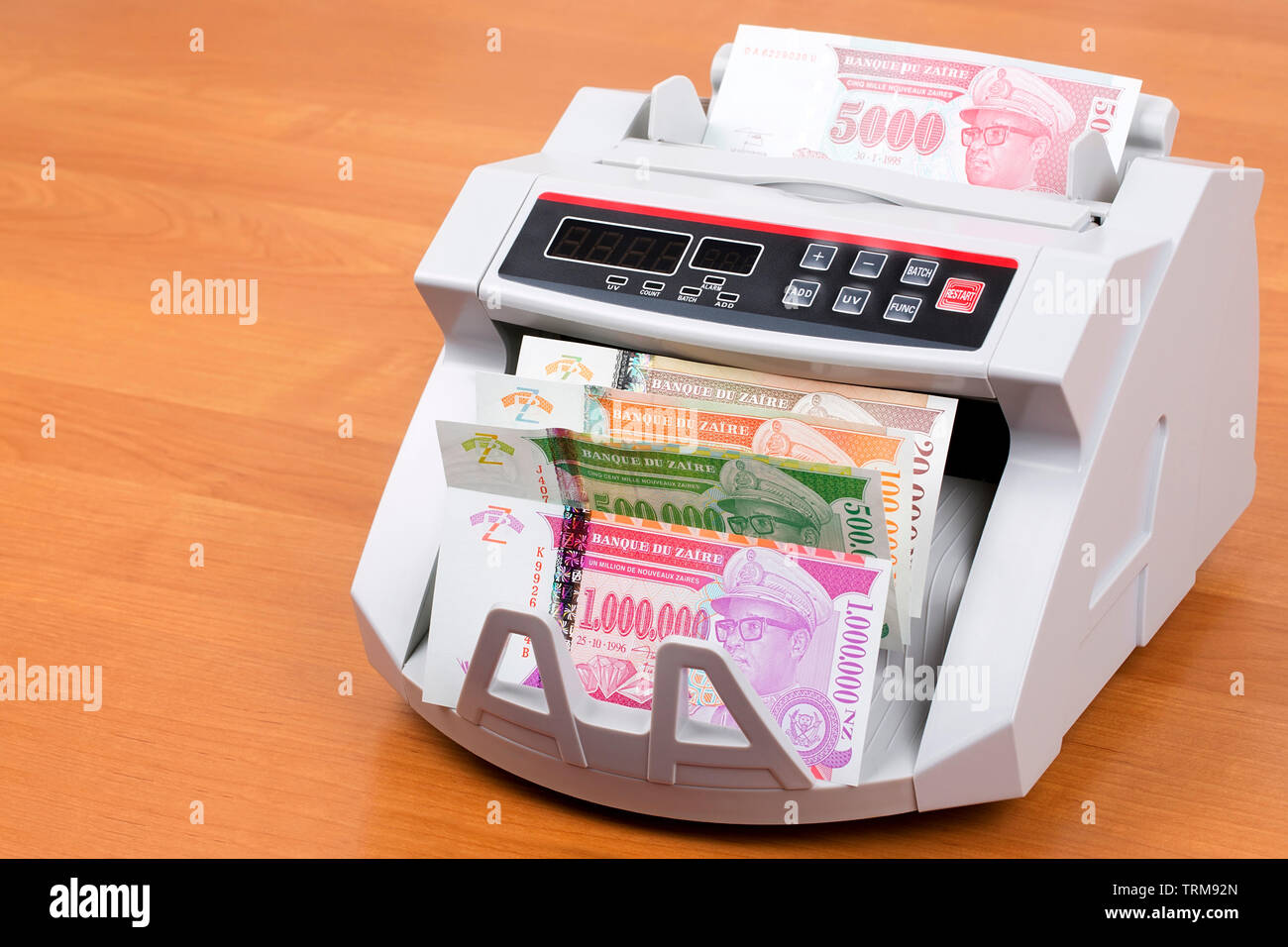 Zairean money in a counting machine - Stock Image