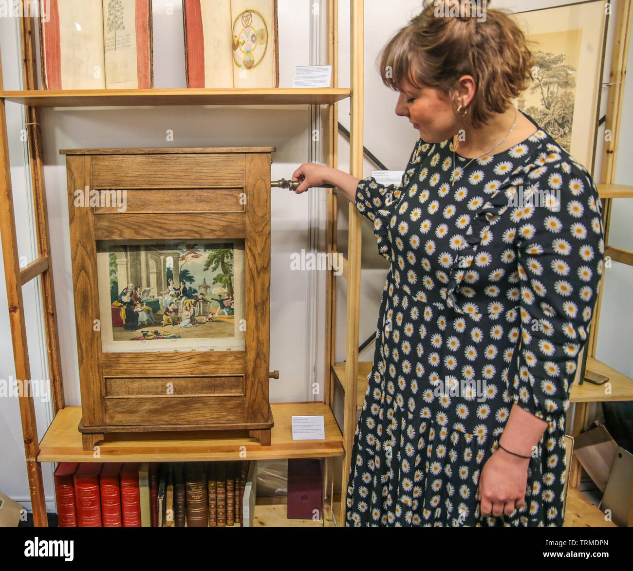 London, UK. 09th June, 2019.  The London's First Rare Book Fair, Benjamin Spaceman rare books offering one of the few known Rudiment Box in the world, originally owned by Darton and Sons from London .circa 1840.The Darton Rudiment Box was an educational tool for children in schools and nursery, its use was recorded in schools in England and Ireland from 1830's onwards. The basic design consisted of prints pasted on linen or paper and attached to two rollers. Credit: Paul Quezada-Neiman/Alamy Live News Stock Photo