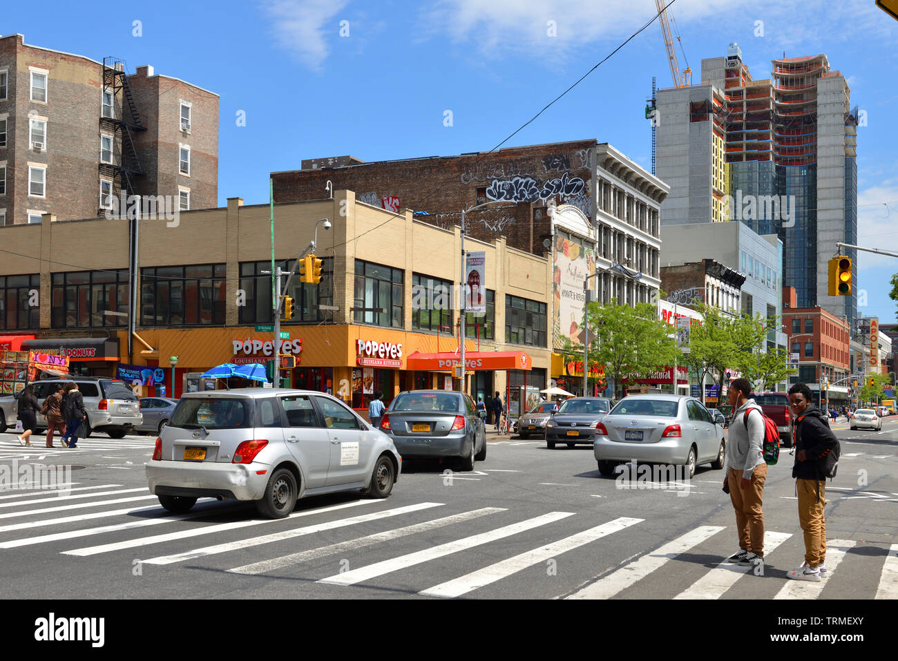 125th Street, often considered to be 'Main Street' of Harlem, and co-named Martin Luther King Jr. Boulevard - Stock Image