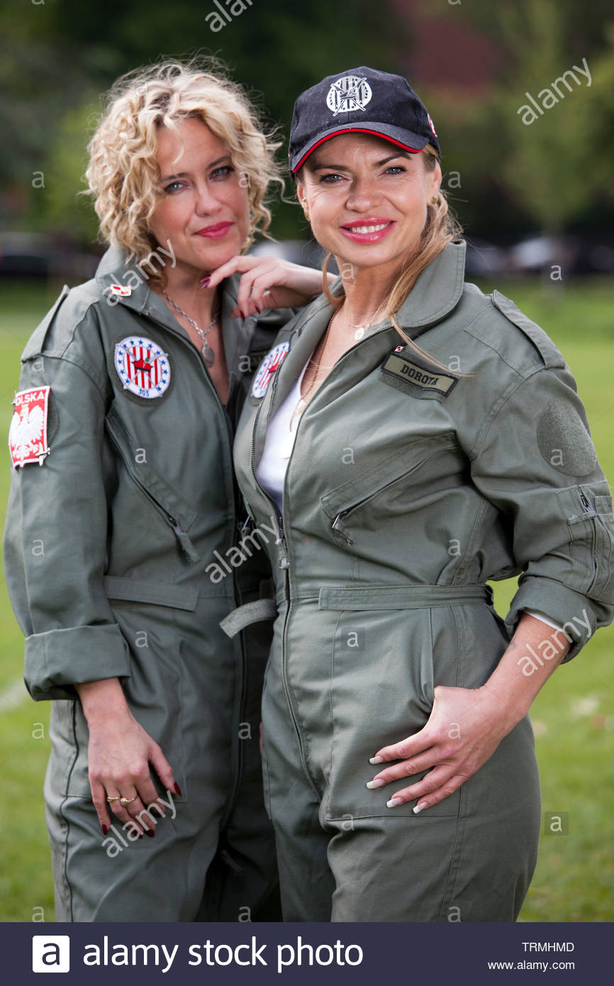 Two beautiful women in traditional polish pilot uniforms during Polish Heritage Day. - Stock Image