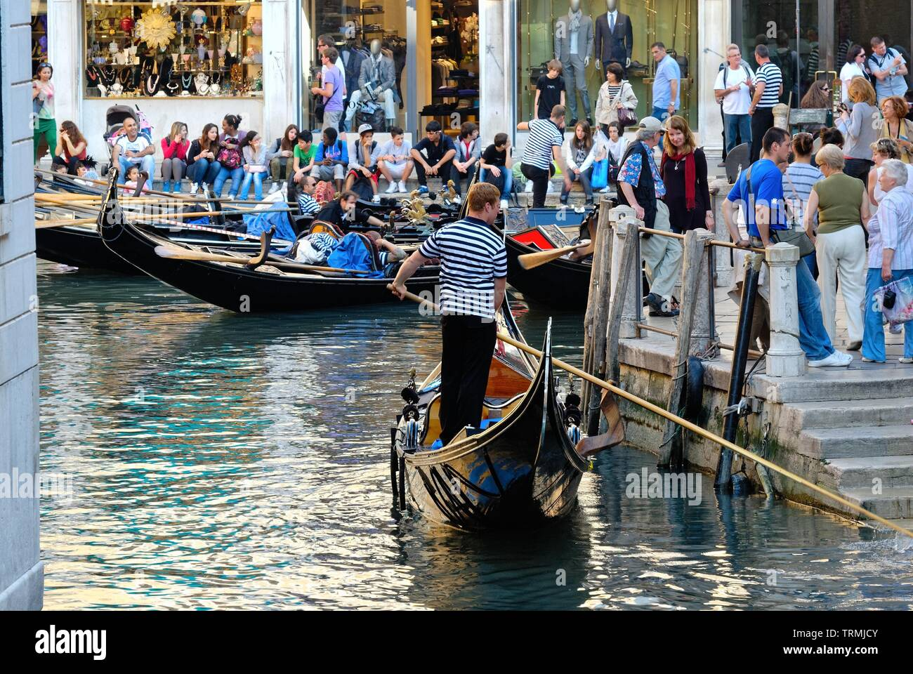 The Bacino Orseolo with crowded tourists and gondolas, Venice Italy Europe EU - Stock Image