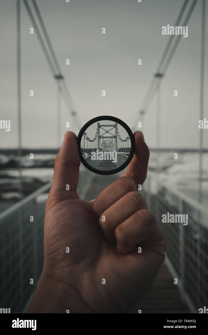 Photoshop manipulation of a bridge view trough nd filter. - Stock Image