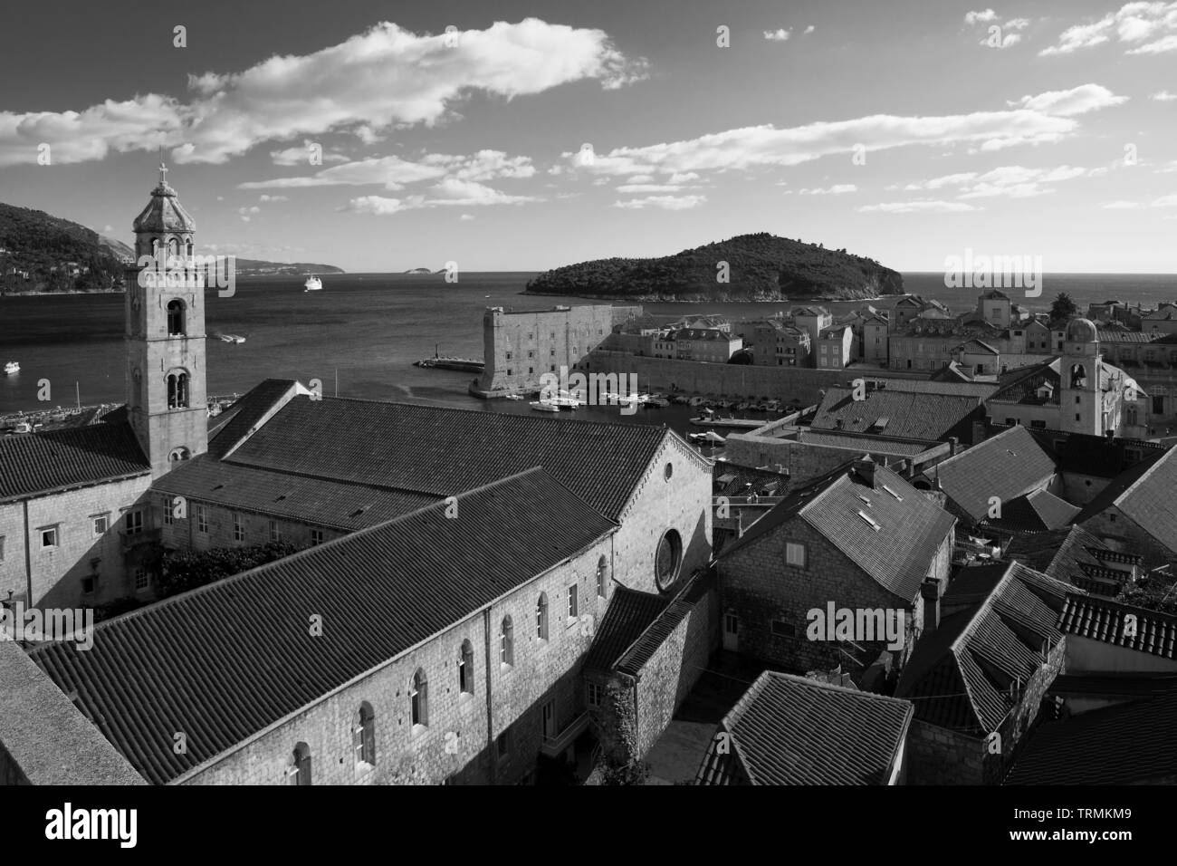 View from the city walls, over the old town of Dubrovnik, Croatia: Dominican monastery, old harbour, the island of Lokrum beyond.  Black and white - Stock Image