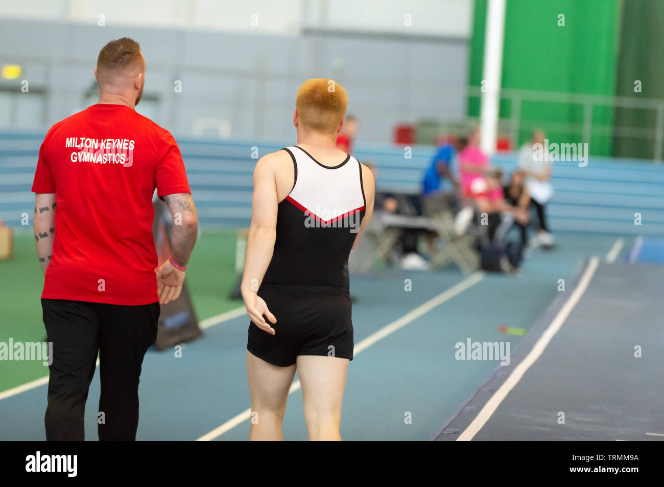 Sheffield, England, UK. 2 June 2019. Coach Michael French (L) and William Breslin (R) from Milton Keynes Gymnastics Club in action during Spring Series 2 at the English Institute of Sport, Sheffield, UK. - Stock Image