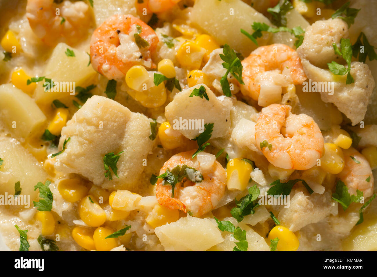 A chowder made from line-caught pollack, Pollachius pollachius, that was caught in the English Channel and king prawns bought from a UK supermarket an - Stock Image