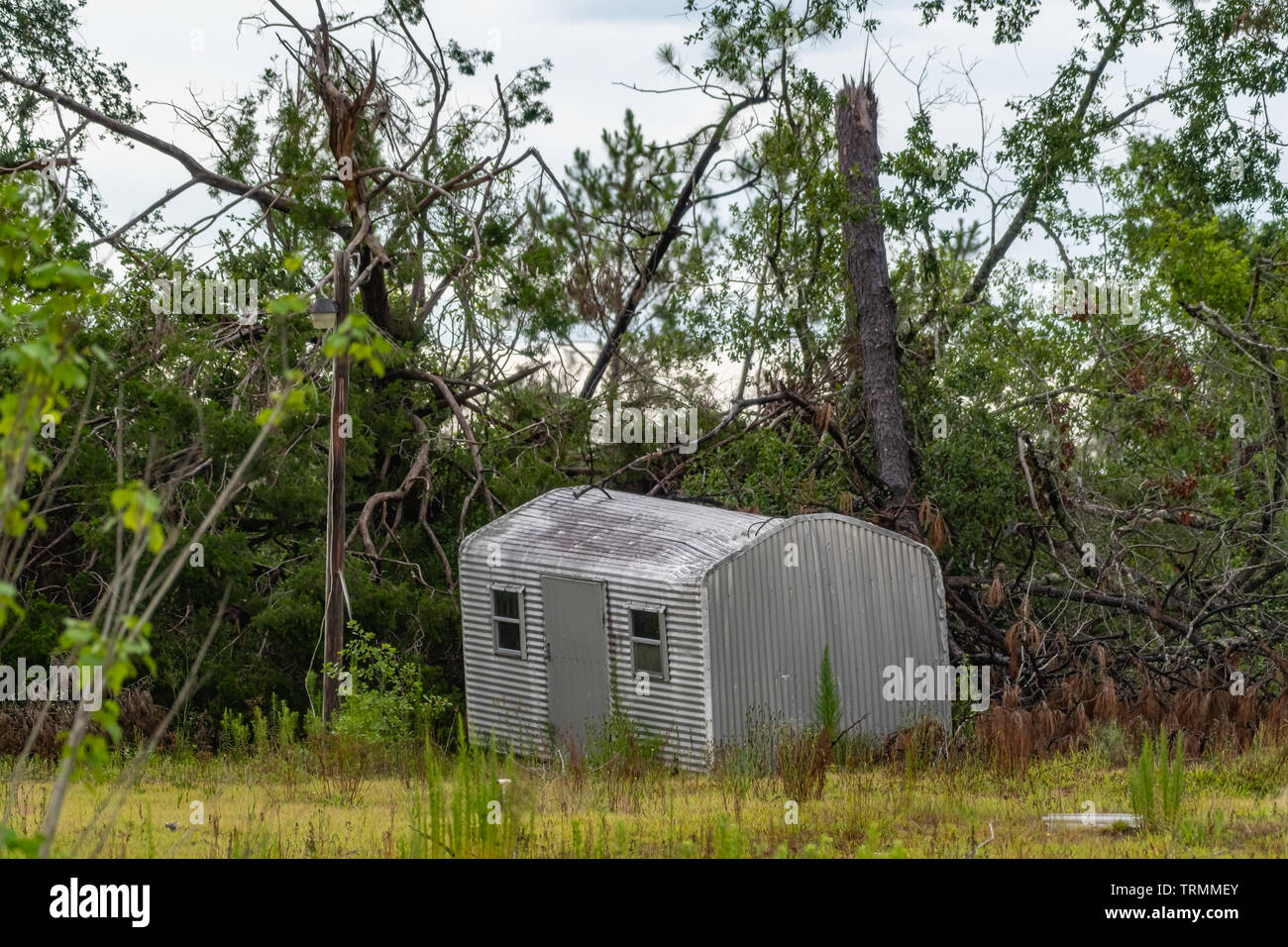 Metal storage shed picked up and moved by hurricane michael - Stock Image