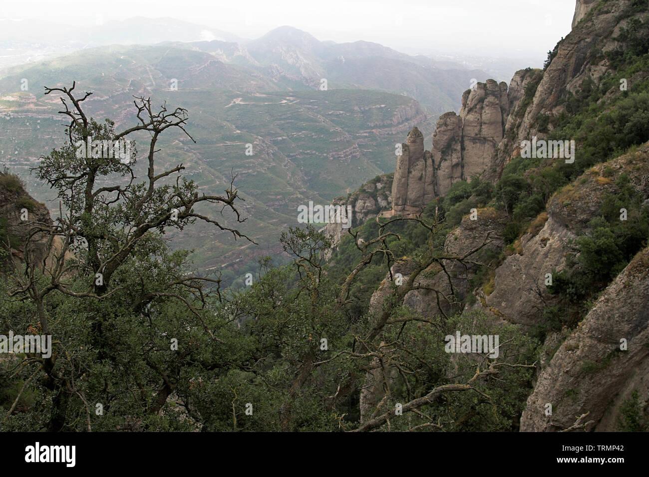 Rocks and hills near Montserrat, Catalonia, Spain. Felsen und Hügel nahe Montserrat, Katalonien, Spanien. Skały i wzgórza w okolicy Montserrat. - Stock Image