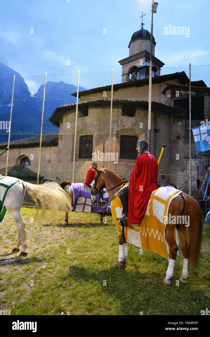 Primaluna/Italy - June 21, 2014: Medieval knight character ready for rings competition during the Medieval festival of six fractions of the town. Stock Photo