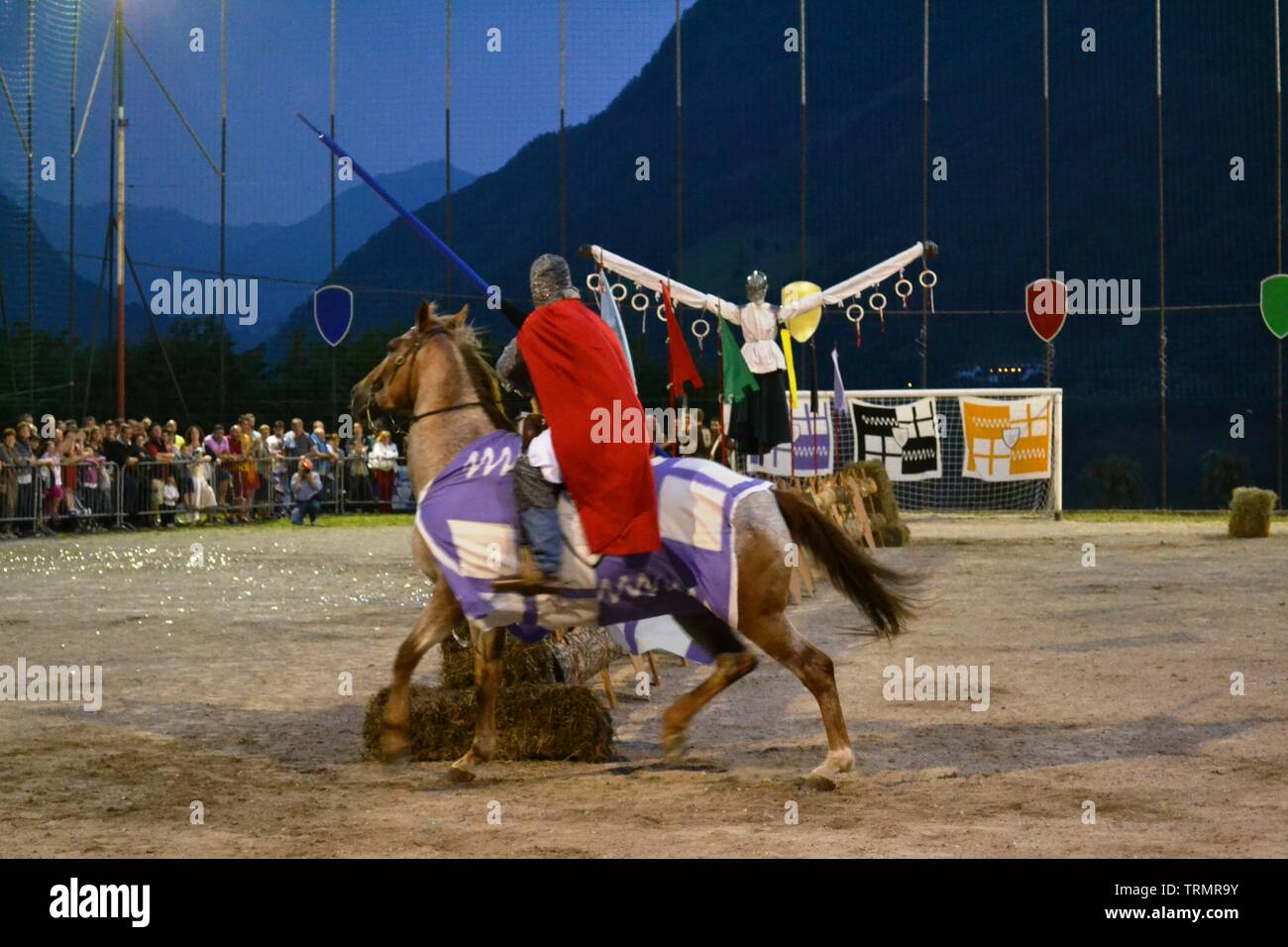 Primaluna/Italy - June 21, 2014: Medieval knight character competing during rings competition of the traditional village Medieval festival of the town Stock Photo