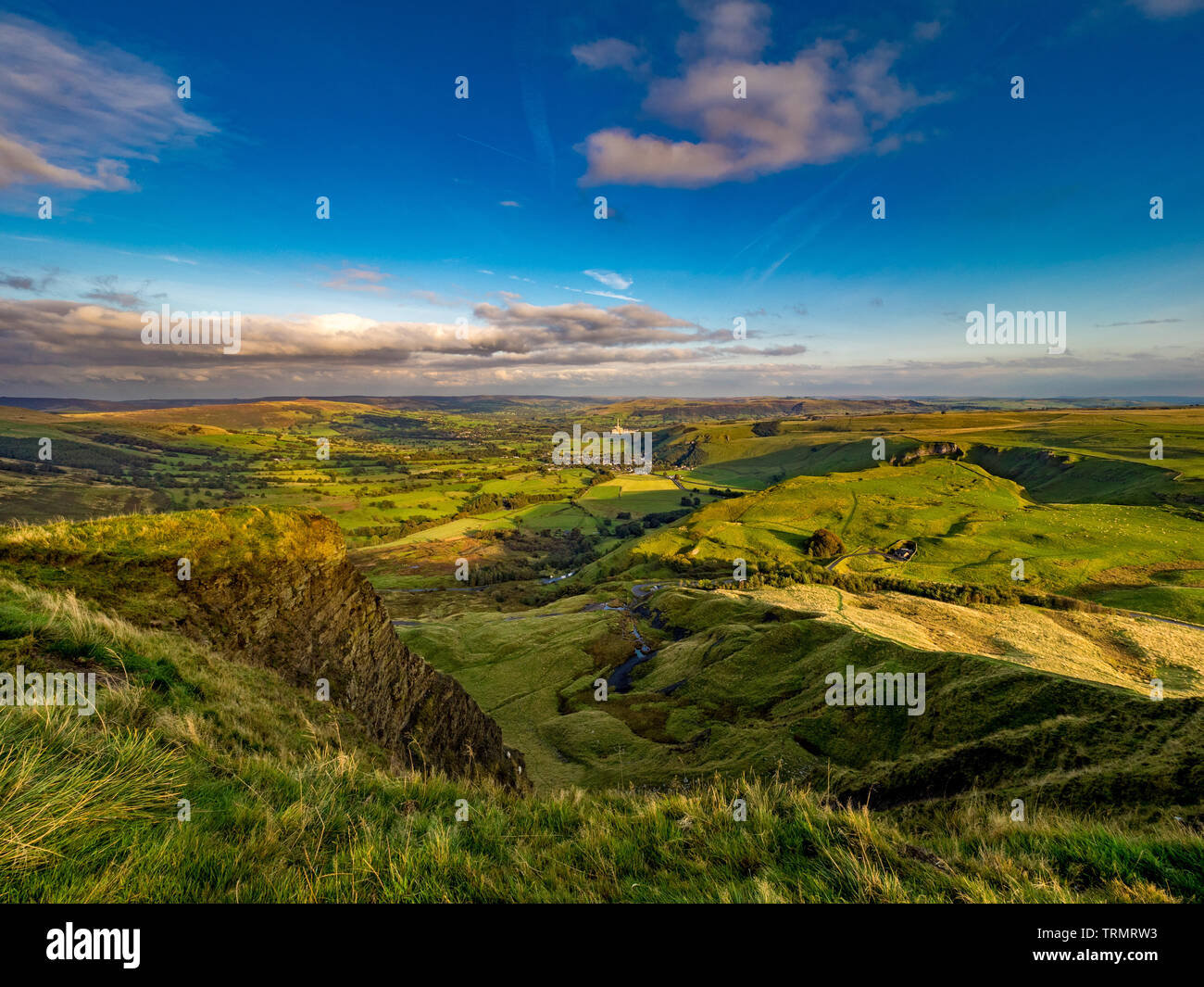 View from summit of Mam Tor down towards Castleton and Hope Valley with Breedon Hope Cement Works in distance, Peak District, UK. - Stock Image