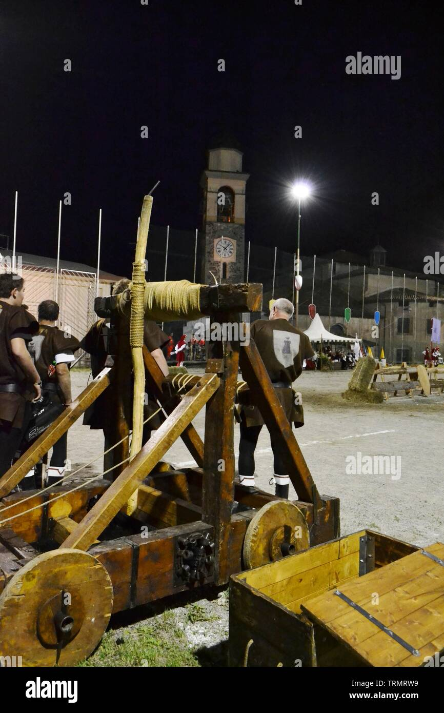 Primaluna/Italy - June 21, 2014: Medieval catapult wooden engine exposed during the traditional village festival of six fractions of the town. Stock Photo