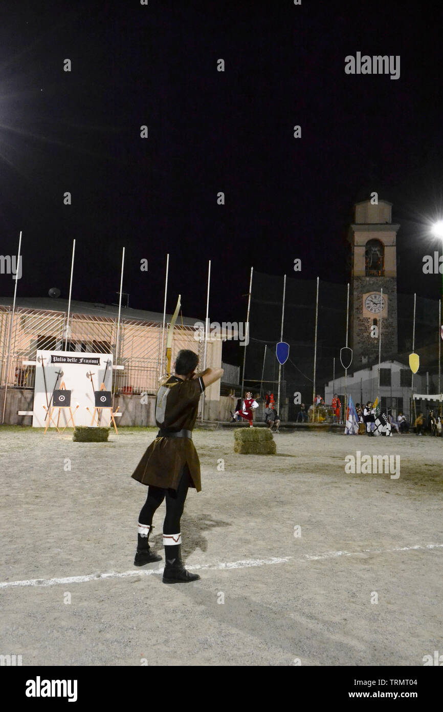 Primaluna/Italy - June 21, 2014: Medieval archer competition during the traditional village festival of six fractions of the town. Stock Photo