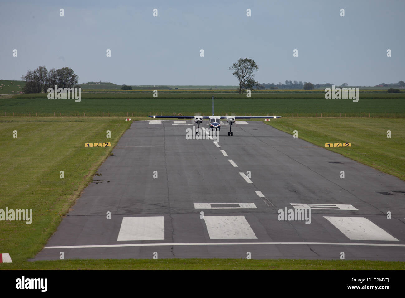 Twin engined aircraft taking off for East Frisian Islands. Germany. - Stock Image