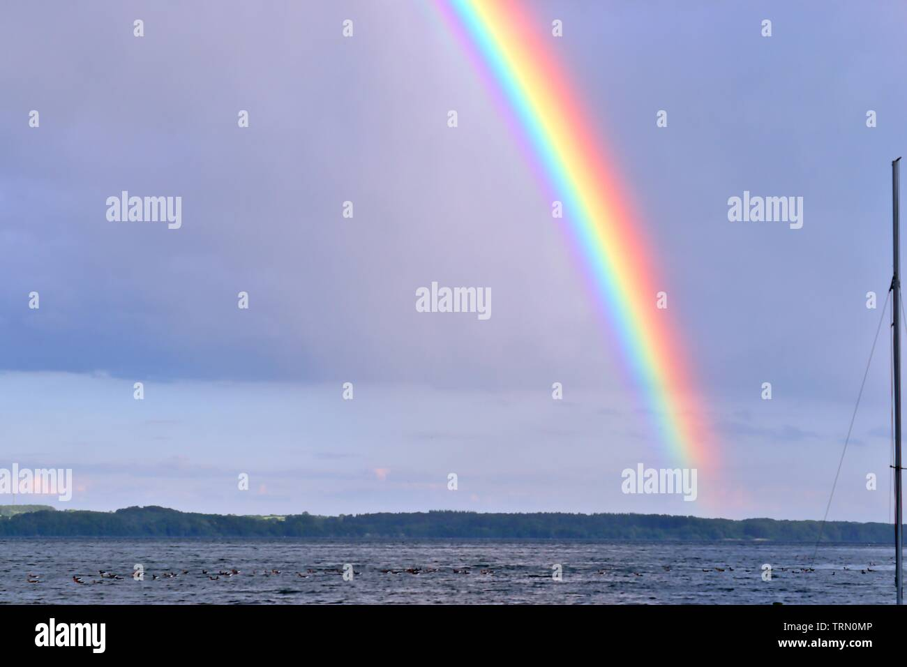 Stunning natural double rainbows plus supernumerary bows seen at a lake in northern germany - Stock Image
